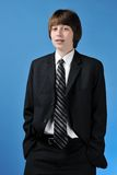 Teenage boy in business suit Stock Images