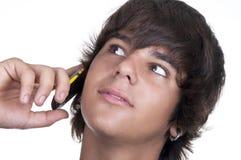 Teenage boy calling from a mobile. Teenage boyl calling from a mobile on white background Royalty Free Stock Photos
