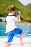 Teenage boy with camera Royalty Free Stock Photos