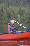 Teenage boy canoeing Stock Photo