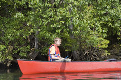 Teenage boy canoeing Royalty Free Stock Images