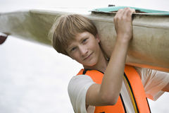 Teenage Boy Carrying Kayak Stock Photos