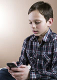 Teenage boy with cell phone Stock Photo