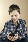 Teenage boy with cell phone. Happy Teenage boy with cell phone Royalty Free Stock Images
