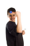 Teenage boy cheers playing darts Stock Photography