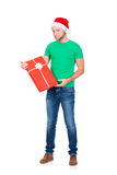 Teenage boy in a Christmas hat and green shirt Royalty Free Stock Image