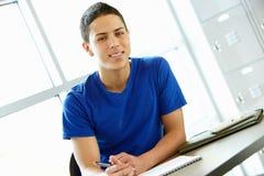 Teenage boy in class Royalty Free Stock Photo