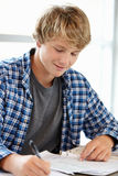 Teenage boy in class Royalty Free Stock Photography