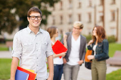 Teenage boy with classmates on the back Stock Photo