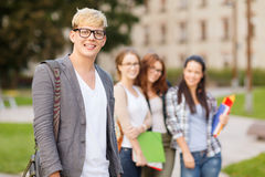 Teenage boy with classmates on the back Royalty Free Stock Images