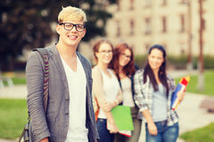 Teenage boy with classmates on the back Stock Image
