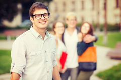 Teenage boy with classmates on the back Royalty Free Stock Photography