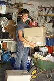 Teenage Boy Clearing Garage For Yard Sale Royalty Free Stock Photos