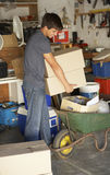 Teenage Boy Clearing Garage For Yard Sale Stock Images
