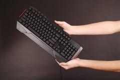 Teenage boy with computer keyboard Royalty Free Stock Photo