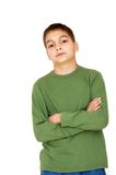 Teenage boy with crossed arms over white Royalty Free Stock Images