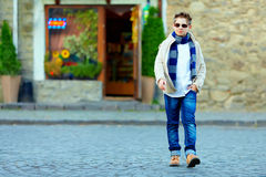 Teenage boy crossing the street of old town Royalty Free Stock Photo