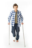 Teenage Boy with crutches and a bandage on his right leg Royalty Free Stock Photo