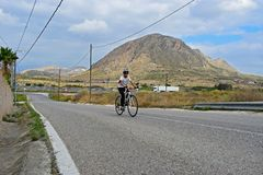 A Teenage Boy Cycling In Stunning Scenery Royalty Free Stock Photos