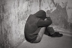 Teenage boy in a deep depression Stock Images