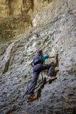Teenage boy doing free climbing Royalty Free Stock Photo