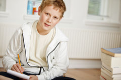 Teenage boy doing his homework Stock Photo