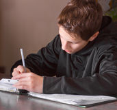 Teenage Boy Doing Homework Stock Image