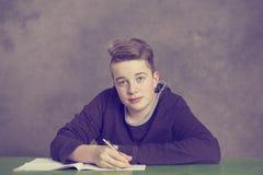 Teenage boy doing homework Royalty Free Stock Photos