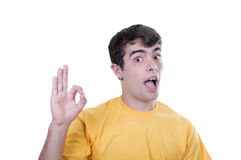 Teenage boy doing Ok gesture Stock Photography