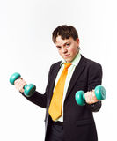 Teenage boy dressed in office suit doing sport exercises Royalty Free Stock Photography