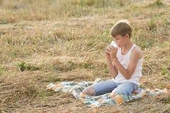 Teenage boy drinking milk during break Royalty Free Stock Photography