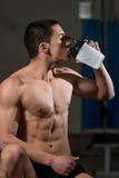 Teenage Boy Drinking A Water Bottle Royalty Free Stock Image
