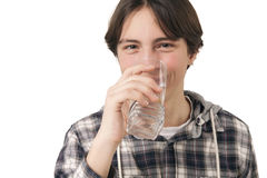 Teenage boy drinking water. Isolated on white background Royalty Free Stock Photos
