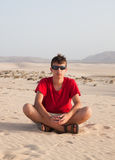 Teenage boy in dunes Stock Images