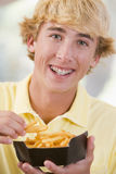 Teenage Boy Eating French Fries Stock Photos