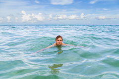 Teenage boy enjoys swimming Royalty Free Stock Photos