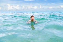 Teenage boy enjoys swimming Stock Photography