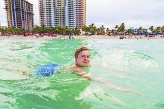 Teenage boy enjoys swimming Stock Photos