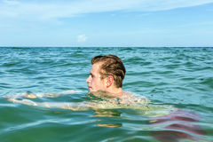 Teenage boy enjoys swimming in the ocean Royalty Free Stock Images