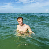 Teenage boy enjoys swimming in the ocean Stock Photography
