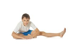 Teenage boy exercising yoga Stock Photo