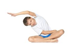 Teenage boy exercising yoga Stock Photos
