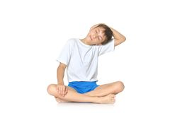 Teenage boy exercising yoga Stock Images