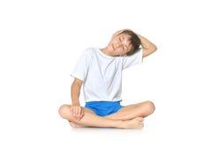 Teenage boy exercising yoga Stock Images