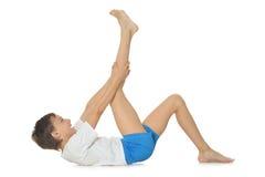 Teenage boy exercising yoga Stock Photography