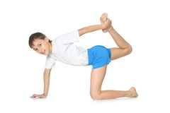 Teenage boy exercising yoga Royalty Free Stock Photography