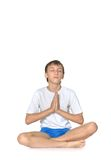 Teenage boy exercising yoga Royalty Free Stock Photos