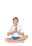 Teenage boy exercising yoga Royalty Free Stock Photos