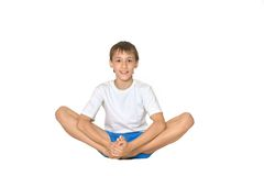 Teenage boy exercising yoga Stock Photography