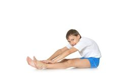 Teenage boy exercising yoga Royalty Free Stock Photo